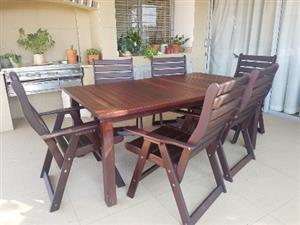Rhodesian Teak garden table &  6 chairs & cushions for sale. Offers will be considered.