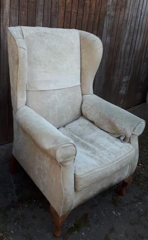 Beige wingback chair