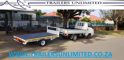 FLATBED TRAILERS. TRAILERS UNLIMITED.