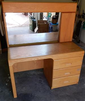 Solid Oak Dressing Table with 3 bottom drawers as well as storage next to Mirror