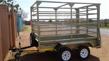 SMALL DOUBLE AXLE  CATTLE TRAILER FOR SALE, SLIDING GATE AT THE BACK