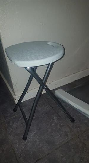 White broken fold up chair
