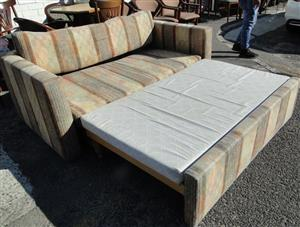 Beautiful 2 Seater Brown floral Sofa/Bed/Sleeper couch -R2200 Neg