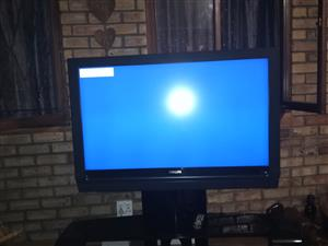 130cm plasma TV on its own stand TV swivels on stand