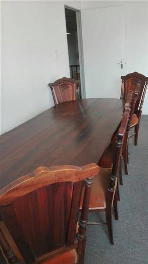 Stink wood table and chairs for sale.