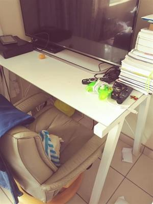 Glass desk with metal legs