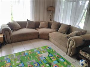 Corner couch with cushions for sale