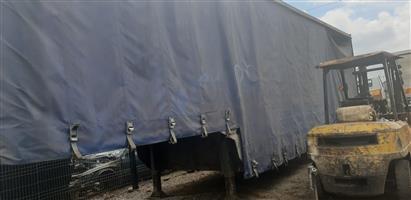 12m trailer, semi curtain rail.double axle,Henred Fruehauf . Call or whatsapp 0828487564