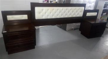 Large dark wooden headboard with white material