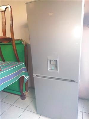 Kic fridge freezer with water dispenser.