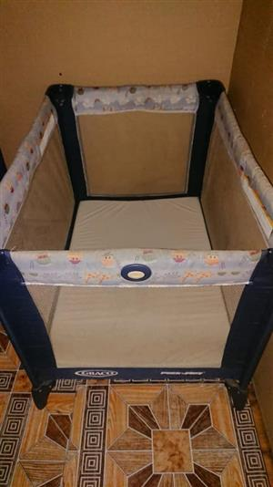 Dark blue Graco camp cot