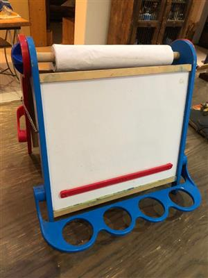 Kids Activity centre featuring a blackboard and a whiteboard and paper roll