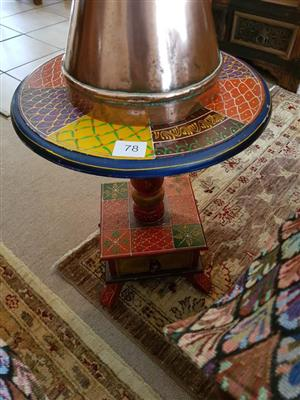 Multi colored round side table with drawer