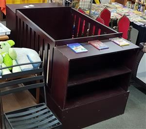 Dark wooden cot with side shelves