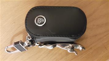 """Jaguar key rings (2) (1 metal Jaguar & 1 """"Leather"""" zipper type)"""