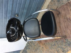 Professional hairdressers backwashes basin and stool