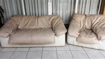 Two Piece Beige Lounge Set Synthetic Leather.One Two-Three Seater.One One Seater,Still in Good Condition.