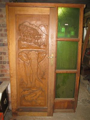 Wooden door with elephant motive and frame