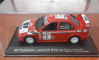 Red mitsubishi lancer evo 2 racing car