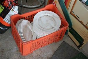 Crate full of white plates