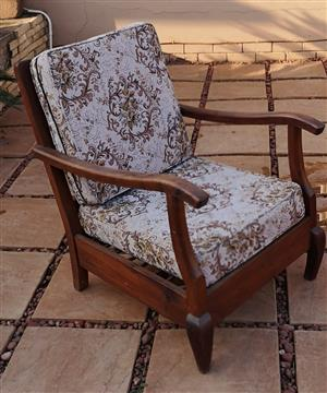 Antique wooden chair with cushions