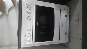 Defy slimline under counter stove with stainless steel solid plate's hob.
