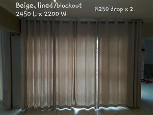 Beige lined block out curtains