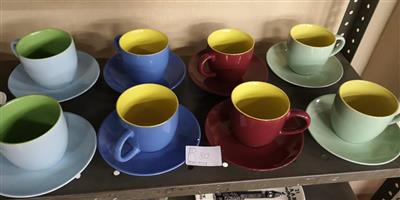 Various colored cups and saucer sets