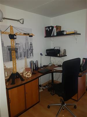 Large L-shape study/office desk with executive chair and matching shelves.