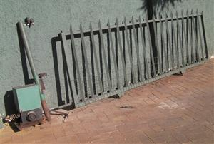 Well built driveway gate on wheels (sliding) together with Hansa Motor