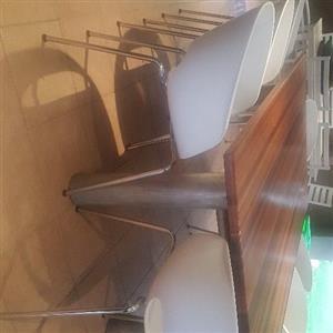 8 white chairs