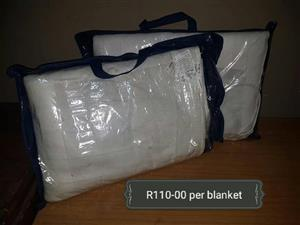 2 White blankets for sale