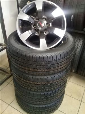Isuzu 18 inch rims with 265/60/18 Continental cross contact on special for R10999 set.