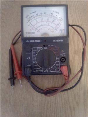 A hung-chan analog multimeter.