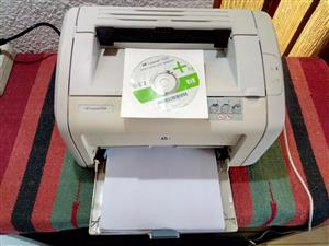HP LasetJet 1018 Lazer Printer. With Power Cable, USB Cable and Installation CD. In good working condition.