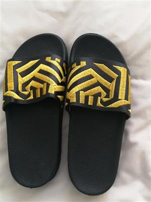Black and yellow sandals for sale