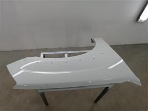 New Isuzu driver side fender for sale.
