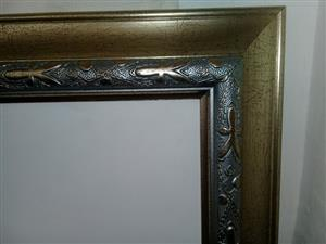 Silver and bronze framed mirror