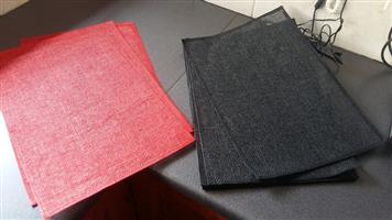 Black and orange place mats set