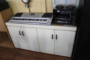 Silver keyboard,mini stove and white cabinet