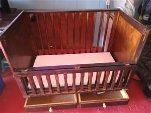Wooden cot with mattress and protector