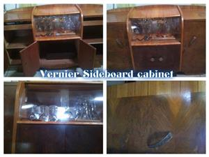 SIDEBOARD CABINET WITH ROUNDED GLASS.
