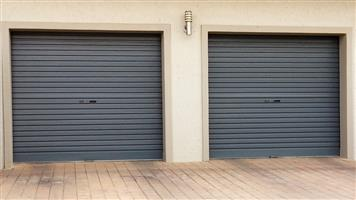 2 ROLL-UP GARAGE DOORS FOR SALE