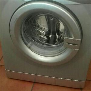 Silver Defy front loader washing machine