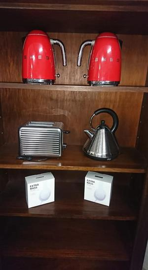Red Smeg kettles and silver toaster