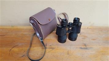 Lovely old pair of small Simor binoculars.