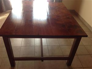 Solide Rhodesian Teak table , old and solid.
