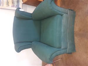 Jade-green wingback armchair