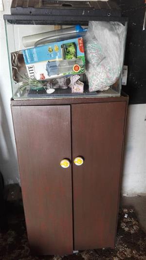 Dark wooden cabinet with fish tank
