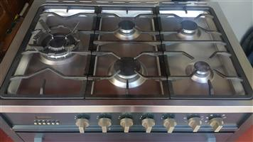 Kelvinator Gas Stove with electric oven and 5 Top Gas Burners for sale